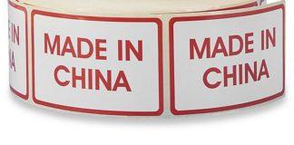 Adesivi bianchi con bordo rosso e scritta Made in China.