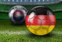 palloni da calcio con la bandiera della germania e della corea